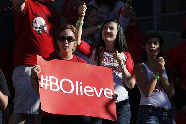 Sep 21, 2013; Lincoln, NE, USA; Nebraska Cornhuskers fan holds a sign during the game against the South Dakota State Jackrabbits in the third quarter at Memorial Stadium. Mandatory Credit: Bruce Thorson-USA TODAY Sports