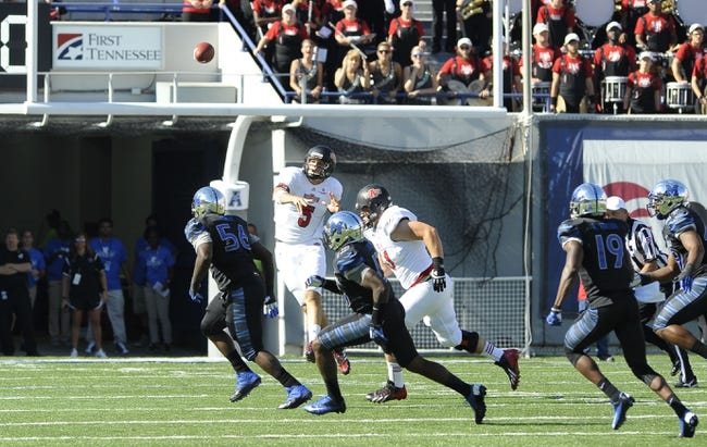 Sep 21, 2013; Memphis, TN, USA; Arkansas State Red Wolves quarterback Adam Kennedy (5) throws under pressure  at Liberty Bowl Memorial. Mandatory Credit: Justin Ford-USA TODAY Sports