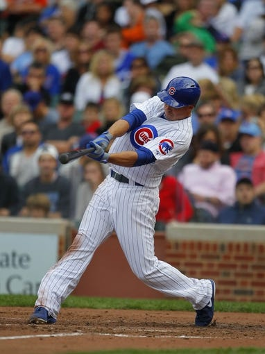 Sep 21, 2013; Chicago, IL, USA; Chicago Cubs left fielder Brian Bogusevic (47) hits a single in the seventh inning against the Atlanta Braves at Wrigley Field. Mandatory Credit: Dennis Wierzbicki-USA TODAY Sports