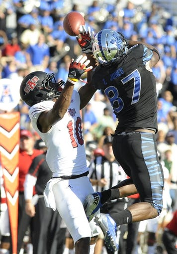 Sep 21, 2013; Memphis, TN, USA; Arkansas State Red Wolves defensive back Artez Brown (10) breaks up pass intended for Memphis Tigers defensive back Bakari Hollier (37) at Liberty Bowl Memorial. Mandatory Credit: Justin Ford-USA TODAY Sports