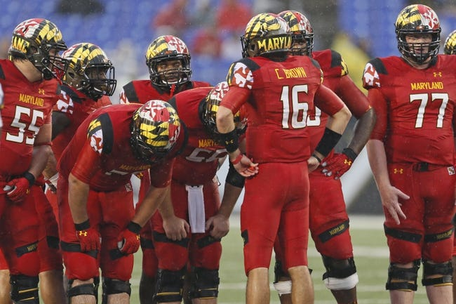 Sep 21, 2013; Baltimore, MD, USA; Maryland Terrapins quarterback CJ Brown (16) leads the offensive huddle during the game against the West Virginia Mountaineers at M&T Bank Stadium. Mandatory Credit: Mitch Stringer-USA TODAY Sports