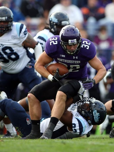 Sep 21, 2013; Evanston, IL, USA; Northwestern Wildcats running back Mike Trumpy (32) runs with the ball against the Maine Black Bears during the third quarter at Ryan Field.  Mandatory Credit: Jerry Lai-USA TODAY Sports