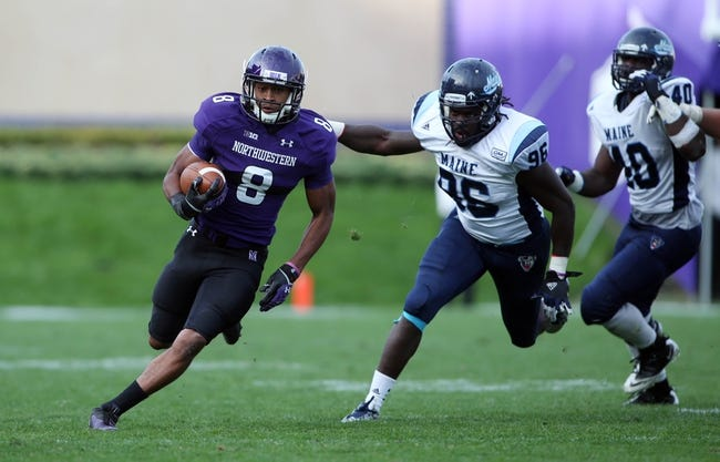 Sep 21, 2013; Evanston, IL, USA; Northwestern Wildcats running back Stephen Buckley (8) runs with the ball against the Maine Black Bears during the fourth quarter at Ryan Field.  Mandatory Credit: Jerry Lai-USA TODAY Sports