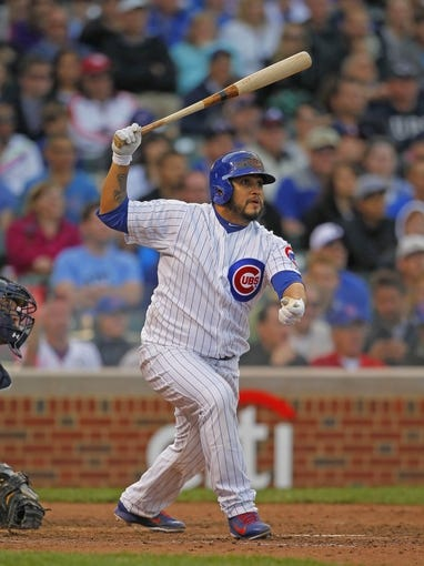 Sep 21, 2013; Chicago, IL, USA; Chicago Cubs catcher Dioner Navarro (30) hits an RBI single in the eighth inning against the Atlanta Braves at Wrigley Field. Chicago won 3-1. Mandatory Credit: Dennis Wierzbicki-USA TODAY Sports
