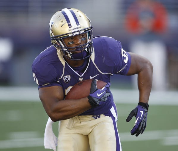 Sep 21, 2013; Seattle, WA, USA; Washington Huskies running back Ryan McDaniel (31) rushes against the Idaho State Bengals during the fourth quarter at Husky Stadium. Mandatory Credit: Joe Nicholson-USA TODAY Sports