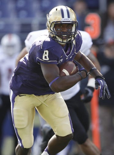 Sep 21, 2013; Seattle, WA, USA; Washington Huskies wide receiver Kevin Smith (8) runs for yards after the catch against the Idaho State Bengals during the first quarter at Husky Stadium. Mandatory Credit: Joe Nicholson-USA TODAY Sports