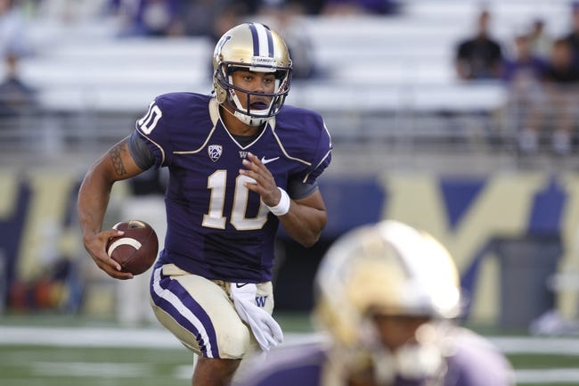 Sep 21, 2013; Seattle, WA, USA; Washington Huskies quarterback Cyler Miles (10) rushes against the Idaho State Bengals during the fourth quarter at Husky Stadium. Mandatory Credit: Joe Nicholson-USA TODAY Sports