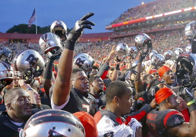 Sep 21, 2013; Piscataway, NJ, USA;  Rutgers Scarlet Knights celebrate come from behind victory over Arkansas Razorbacks at High Points Solutions Stadium. Rutgers Scarlet Knights defeat the Arkansas Razorbacks 28-24. Mandatory Credit: Jim O'Connor-USA TODAY Sports