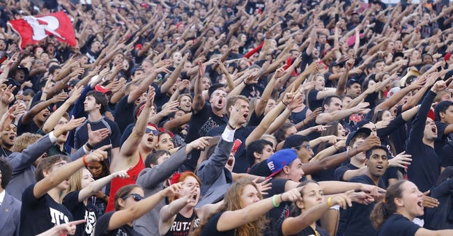 Sep 21, 2013; Piscataway, NJ, USA;  Rutgers Scarlet Knights student body cheering on their team in come from behind victory against the Arkansas Razorbacks at High Points Solutions Stadium. Rutgers Scarlet Knights defeat the Arkansas Razorbacks 28-24. Mandatory Credit: Jim O'Connor-USA TODAY Sports