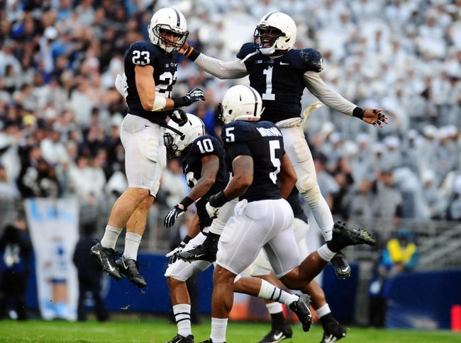 Sep 21, 2013; University Park, PA, USA; Penn State Nittany Lions safety Ryan Keiser (23) is congratulated by safety Malcolm Willis (1) after intercepting a pass against the Kent State Golden Flashes at Beaver Stadium. Mandatory Credit: Evan Habeeb-USA TODAY Sports