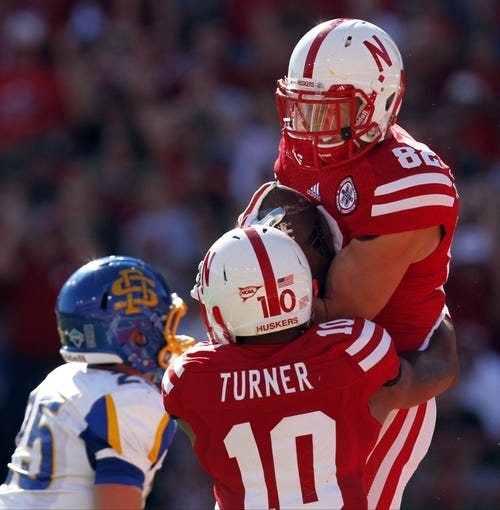 Sep 21, 2013; Lincoln, NE, USA; Nebraska Cornhuskers receiver Tyler Wullenwaber (82) celebrates his touchdown with Jamal Turner (10) during the game against the South Dakota State Jackrabbits in the second quarter at Memorial Stadium. Mandatory Credit: Bruce Thorson-USA TODAY Sports
