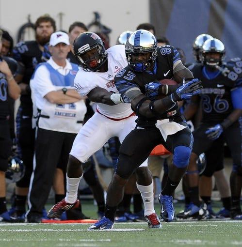 Sep 21, 2013; Memphis, TN, USA; Memphis Tigers wide receiver Daniel Hurd (83) carries the ball against Arkansas State Red Wolves at Liberty Bowl Memorial. Mandatory Credit: Justin Ford-USA TODAY Sports