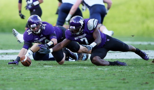 Sep 21, 2013; Evanston, IL, USA; (EDITORS NOTE: caption correction) Northwestern Wildcats defensive lineman Dean Lowry (94) and defensive lineman Ifeadi Odenigbo (7) dive on a fumble by the Maine Black Bears during the fourth quarter at Ryan Field.  Mandatory Credit: Jerry Lai-USA TODAY Sports