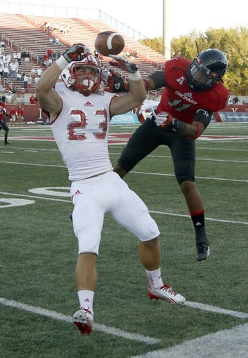 Sep 21, 2013; Oxford, OH, USA; Cincinnati Bearcats cornerback Deven Drane (11) breaks up a pass intended for Miami (Oh) Redhawks wide receiver Austin Green (23) during the fourth quarter at Fred Yager Stadium. Cincinnati won 14-0. Mandatory Credit: David Kohl-USA TODAY Sports