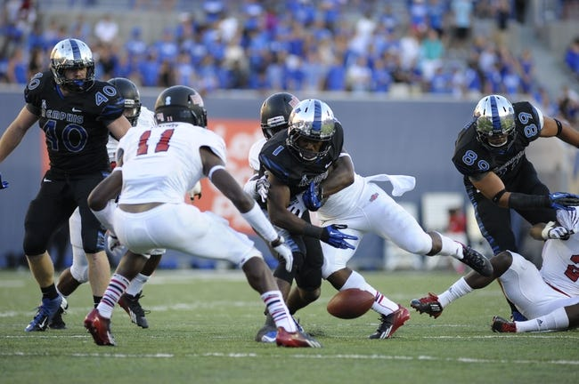 Sep 21, 2013; Memphis, TN, USA; Memphis Tigers running back Marquis Warford (1) fumbles the ball during the game against the Arkansas State Red Wolves at Liberty Bowl Memorial. Mandatory Credit: Justin Ford-USA TODAY Sports