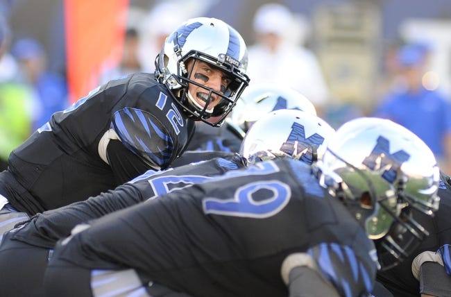 Sep 21, 2013; Memphis, TN, USA; Memphis Tigers quarterback Paxton Lynch (12) calls a play during the game against the Arkansas State Red Wolves at Liberty Bowl Memorial. Mandatory Credit: Justin Ford-USA TODAY Sports