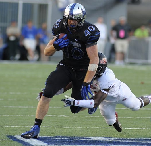 Sep 21, 2013; Memphis, TN, USA; Memphis Tigers tight end Alan Cross (40) carries the ball during the game against the Arkansas State Red Wolves at Liberty Bowl Memorial. Mandatory Credit: Justin Ford-USA TODAY Sports