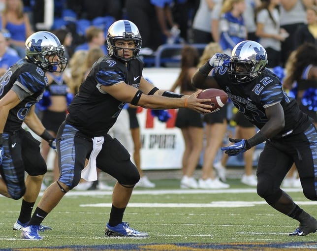 Sep 21, 2013; Memphis, TN, USA; Memphis Tigers quarterback Jacob Karam (9) hands the ball off to running back Doroland Dorceus during the game against the Arkansas State Red Wolves at Liberty Bowl Memorial. Mandatory Credit: Justin Ford-USA TODAY Sports