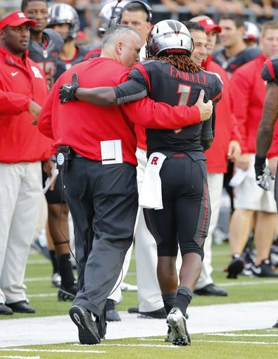 Sep 21, 2013; Piscataway, NJ, USA;  Rutgers Scarlet Knights head coach Kyle Flood congratulates wide receiver Janarion Grant (1) after returning a third quarter Arkansas Razorbacks punt for touchdown at High Points Solutions Stadium. Rutgers won 28-24. Mandatory Credit: Jim O'Connor-USA TODAY Sports