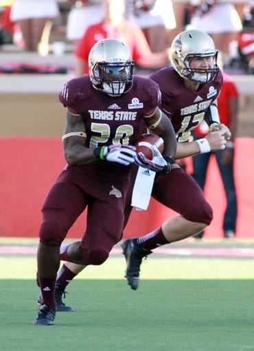 Sep 21, 2013; Lubbock, TX, USA;  Texas State Bobcats running back Terrance Franks (20) rushes against the Texas Tech Red Raiders in the first half at Jones AT&T Stadium. Mandatory Credit: Michael C. Johnson-USA TODAY Sports