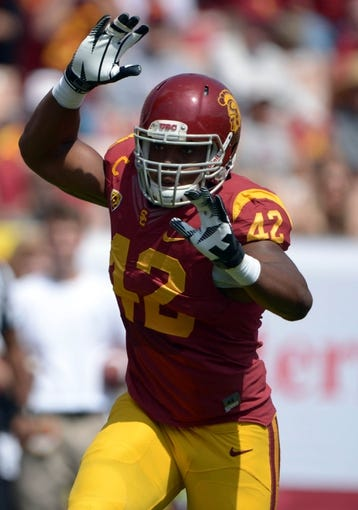 Sep 21, 2013; Los Angeles, CA, USA; Southern California Trojans linebacker Devon Kennard (42) during the game against the Utah State Aggies at the Los Angeles Memorial Coliseum. USC defeated Utah State 17-14. Mandatory Credit: Kirby Lee-USA TODAY Sports