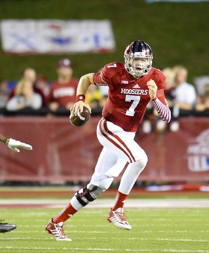Sep 21, 2013; Bloomington, IN, USA; Indiana Hoosiers quarterback Nate Sudfeld (7) drops back to pass against the Missouri Tigers during the first quarter at Memorial Stadium. Mandatory Credit: Mike DiNovo-USA TODAY Sports