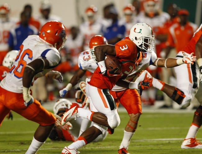 Sep 21, 2013; Miami Gardens, FL, USA;  Miami Hurricanes wide receiver Stacy Coley (3) runs for a touchdown in the second quarter against Savannah State Tigers at Sun Life Stadium. Mandatory Credit: Robert Mayer-USA TODAY Sports