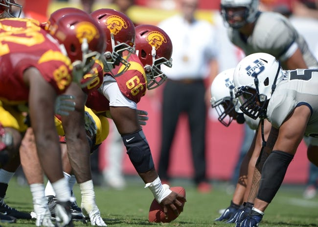 Sep 21, 2013; Los Angeles, CA, USA; General view of the line of scrimmage as Southern California Trojans center Marcus Martin (66) snaps the ball against the Utah State Aggies at the Los Angeles Memorial Coliseum. USC defeated Utah State 17-14. Mandatory Credit: Kirby Lee-USA TODAY Sports