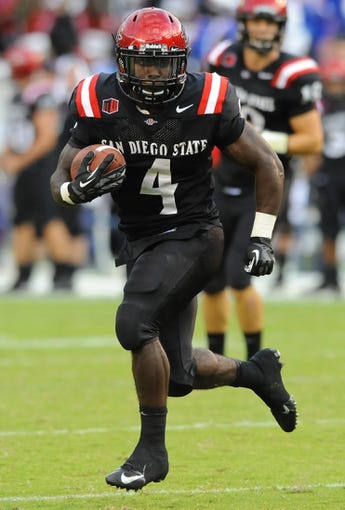 Sep 21, 2013; San Diego, CA, USA; San Diego State Aztecs running back Adam Muema (4) runs for a short gain during the first half against the Oregon State Beavers at Qualcomm Stadium. Mandatory Credit: Christopher Hanewinckel-USA TODAY Sports
