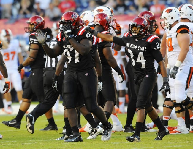 Sep 21, 2013; San Diego, CA, USA; San Diego State Aztecs defenders celebrate after a stop on fourth down during the first half against the Oregon State Beavers at Qualcomm Stadium. Mandatory Credit: Christopher Hanewinckel-USA TODAY Sports