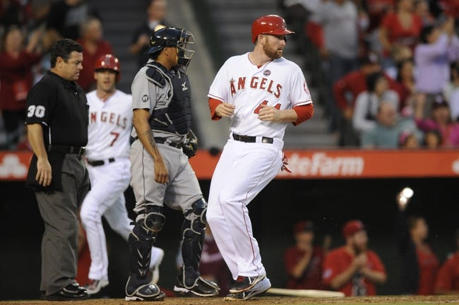 Sep 21, 2013; Anaheim, CA, USA; Los Angeles Angels first baseman Mark Trumbo (44) looks back as he runs in a score off of a three RBI double hit by Los Angeles Angels second baseman Grant Green (not pictured) against the Seattle Mariners during the second inning at Angel Stadium of Anaheim. Mandatory Credit: Kelvin Kuo-USA TODAY Sports