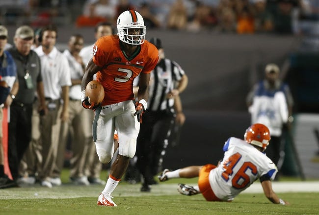 Sep 21, 2013; Miami Gardens, FL, USA; Miami Hurricanes wide receiver Stacy Coley (3) runs past Savannah State Tigers linebacker Warren Sweet (46) for a touchdown  in the second half at Sun Life Stadium. Miami won 77-7. Mandatory Credit: Robert Mayer-USA TODAY Sports