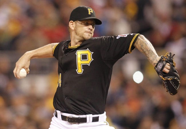 Sep 21, 2013; Pittsburgh, PA, USA; Pittsburgh Pirates starting pitcher A.J. Burnett (34) delivers a pitch against the Cincinnati Reds during the second inning at PNC Park. The Pittsburgh Pirates won 4-2. Mandatory Credit: Charles LeClaire-USA TODAY Sports