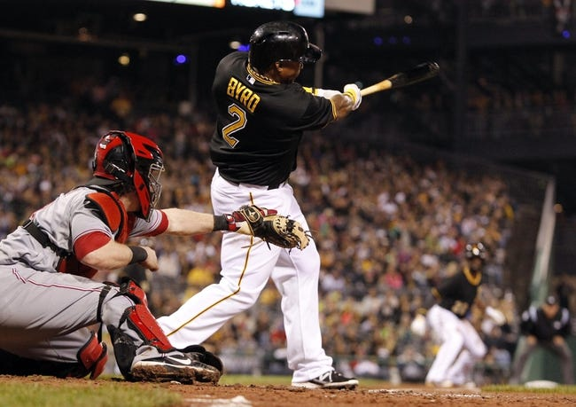 Sep 21, 2013; Pittsburgh, PA, USA; Pittsburgh Pirates right fielder Marlon Byrd (2) hits an RBI single against the Cincinnati Reds during the sixth inning at PNC Park. The Pittsburgh Pirates won 4-2. Mandatory Credit: Charles LeClaire-USA TODAY Sports