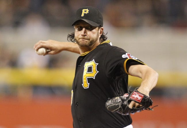Sep 21, 2013; Pittsburgh, PA, USA; Pittsburgh Pirates relief pitcher Jason Grilli (39) pitches against the Cincinnati Reds during the ninth inning at PNC Park. The Pittsburgh Pirates won 4-2. Mandatory Credit: Charles LeClaire-USA TODAY Sports