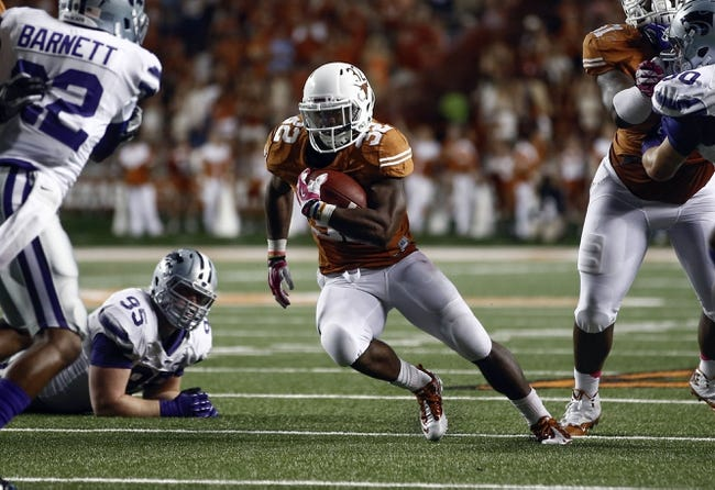 Sep 21, 2013; Austin, TX, USA; Texas Longhorns running back Johnathan Gray (32) rushes past Kansas State Wildcats defensive lineman Travis Britz (95) and defensive back Dante Barnett (22) on his way for a touchdown during the third quarter of a football game at Darrell K Royal-Texas Memorial Stadium. Mandatory Credit: Jim Cowsert-USA TODAY Sports
