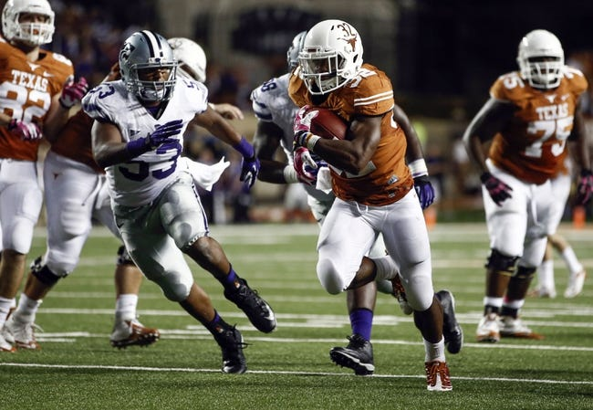 Sep 21, 2013; Austin, TX, USA; Texas Longhorns running back Johnathan Gray (32) rushes past Kansas State Wildcats linebacker Blake Slaughter (53) on his way for a touchdown during the third quarter of a football game at Darrell K Royal-Texas Memorial Stadium. Mandatory Credit: Jim Cowsert-USA TODAY Sports