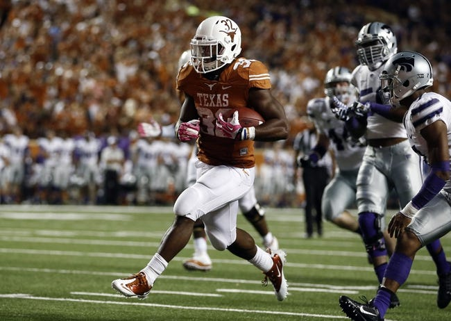 Sep 21, 2013; Austin, TX, USA; Texas Longhorns running back Johnathan Gray (32) rushes past Kansas State Wildcats defensive back Ty Zimmerman (12) and Kansas State Wildcats defensive back Kip Daily (7) on his way for a touchdown during the third quarter of a football game at Darrell K Royal-Texas Memorial Stadium. Mandatory Credit: Jim Cowsert-USA TODAY Sports