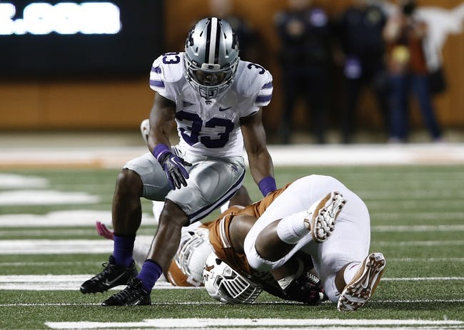 Sep 21, 2013; Austin, TX, USA; Texas Longhorns defensive tackle Desmond Jackson (99) recovers the fumble by Kansas State Wildcats running back John Hubert (33) during the third quarter of a football game at Darrell K Royal-Texas Memorial Stadium. Mandatory Credit: Jim Cowsert-USA TODAY Sports