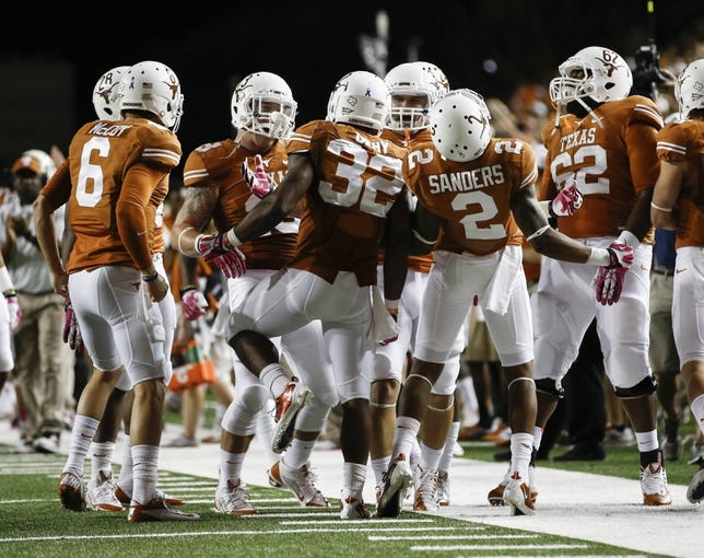 Sep 21, 2013; Austin, TX, USA; Texas Longhorns running back Johnathan Gray (32) celebrates his touchdown with teammates against the Kansas State Wildcats during the third quarter of a football game at Darrell K Royal-Texas Memorial Stadium. Mandatory Credit: Jim Cowsert-USA TODAY Sports
