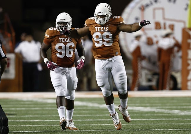Sep 21, 2013; Austin, TX, USA; Texas Longhorns defensive tackle Desmond Jackson (99) celebrates with defensive tackle Chris Whaley (96) his fumble recovery against the Kansas State Wildcats during the third quarter of a football game at Darrell K Royal-Texas Memorial Stadium. Mandatory Credit: Jim Cowsert-USA TODAY Sports