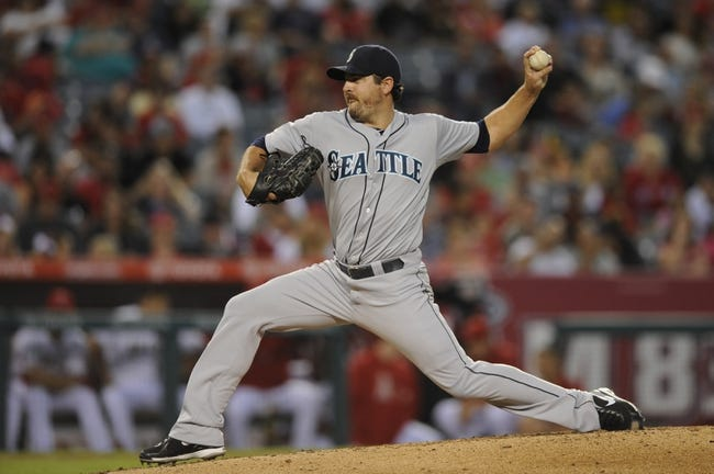 Sep 21, 2013; Anaheim, CA, USA; (Editors note: Caption correction) Seattle Mariners starting pitcher Joe Saunders (23) pitches against the Los Angeles Angels during the second inning at Angel Stadium of Anaheim. Mandatory Credit: Kelvin Kuo-USA TODAY Sports