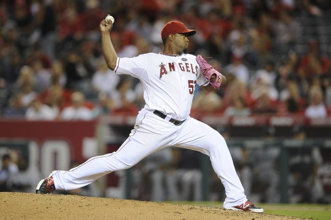 Sep 21, 2013; Anaheim, CA, USA; Los Angeles Angels pitcher Jerome Williams (57) pitches against the Seattle Mariners during the fourth inning at Angel Stadium of Anaheim. Mandatory Credit: Kelvin Kuo-USA TODAY Sports