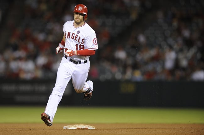 Sep 21, 2013; Anaheim, CA, USA; Los Angeles Angels left fielder Collin Cowgill (19) runs the bases after hitting a solo run home run against the Seattle Mariners during the fourth inning at Angel Stadium of Anaheim. Mandatory Credit: Kelvin Kuo-USA TODAY Sports