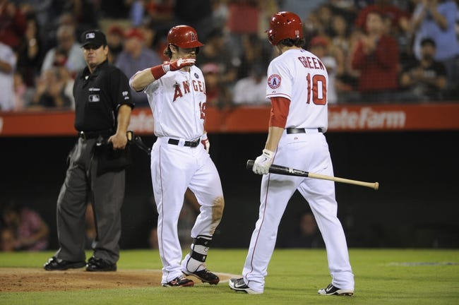 Sep 21, 2013; Anaheim, CA, USA; Los Angeles Angels left fielder Collin Cowgill (19) celebrates with Los Angeles Angels second baseman Grant Green (10) after hitting a solo run home run against the Seattle Mariners during the fourth inning at Angel Stadium of Anaheim. Mandatory Credit: Kelvin Kuo-USA TODAY Sports