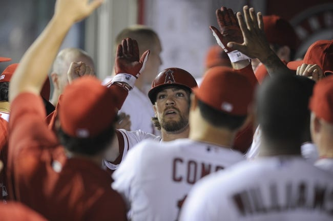 Sep 21, 2013; Anaheim, CA, USA; Los Angeles Angels left fielder Collin Cowgill (19) celebrates after hitting a solo run home run against the Seattle Mariners during the fourth inning at Angel Stadium of Anaheim. Mandatory Credit: Kelvin Kuo-USA TODAY Sports