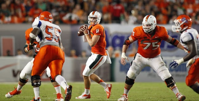 Sep 21, 2013; Miami Gardens, FL, USA; Miami Hurricanes quarterback Ryan Williams (11) drops back to pass against the Savannah State Tigers in the second quarter at Sun Life Stadium. Mandatory Credit: Robert Mayer-USA TODAY Sports