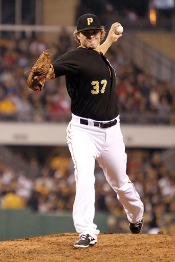 Sep 21, 2013; Pittsburgh, PA, USA; Pittsburgh Pirates relief pitcher Justin Wilson (37) pitches against the Cincinnati Reds during the eighth inning at PNC Park. The Pittsburgh Pirates won 4-2. Mandatory Credit: Charles LeClaire-USA TODAY Sports