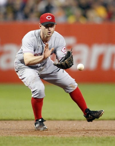 Sep 21, 2013; Pittsburgh, PA, USA; Cincinnati Reds third baseman Jack Hannahan (9) fields a ground ball against the Pittsburgh Pirates during the seventh inning at PNC Park. The Pittsburgh Pirates won 4-2. Mandatory Credit: Charles LeClaire-USA TODAY Sports