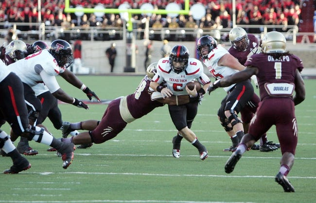 Sep 21, 2013; Lubbock, TX, USA; Texas Tech Red Raiders quarterback Baker Mayfield (6) rushes against the Texas State Bobcats in the first half at Jones AT&T Stadium. Mandatory Credit: Michael C. Johnson-USA TODAY Sports
